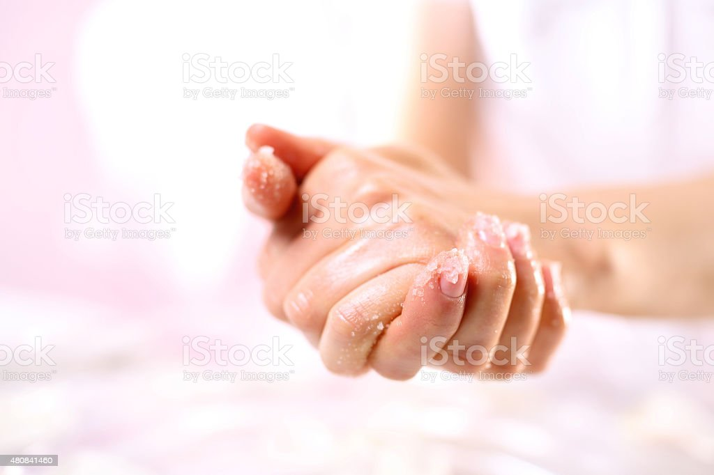 Grained hand peeling stock photo