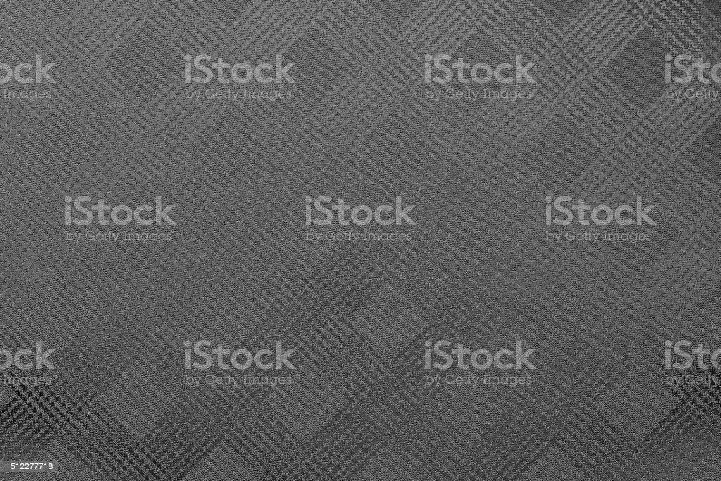 grained texture checkered fabric of dark gray or black color stock photo