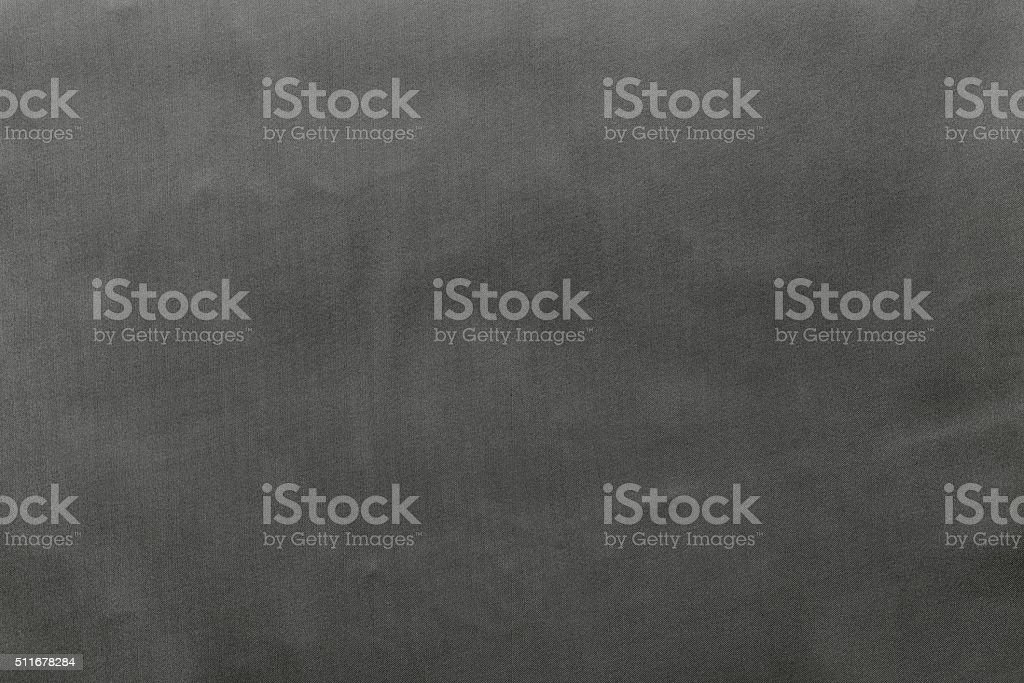 grained textured background from fabric of gray monochrome color stock photo