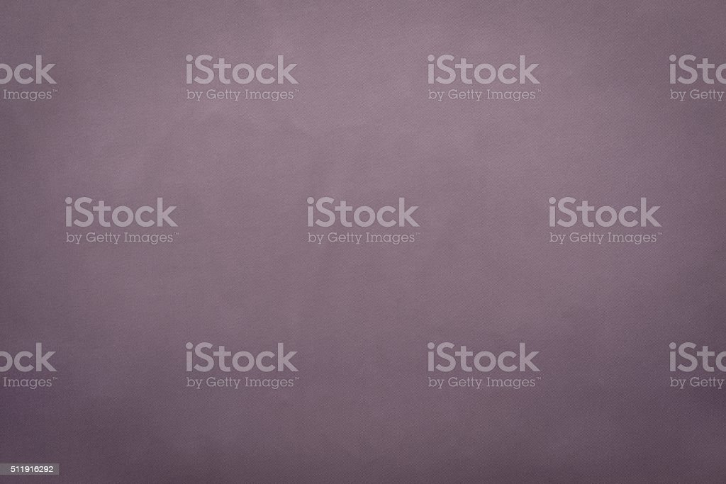 grained textured background from fabric of lilac gray monochrome color stock photo
