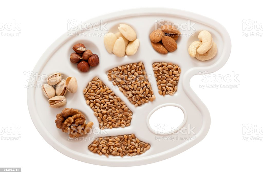 Grains, nuts and almonds on white stock photo