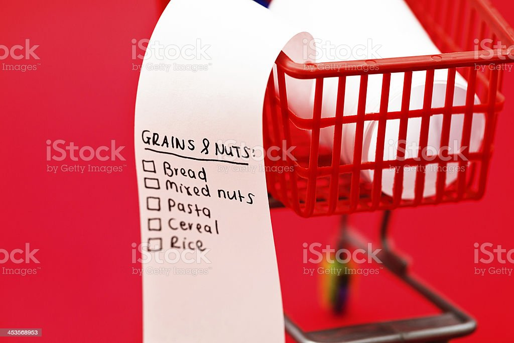 Grains & Nuts head shopping list in tiny supermarket trolley royalty-free stock photo