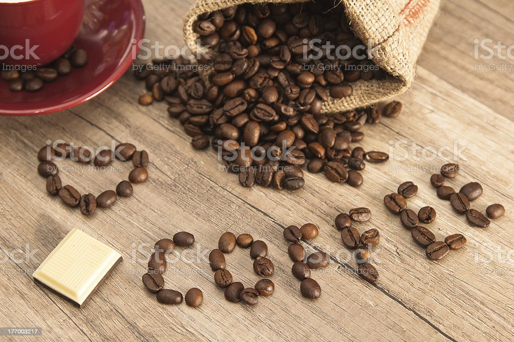 Grains of coffee on a wooden surface royalty-free stock photo