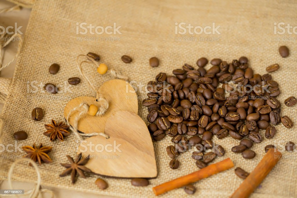 Grains of roasted coffee on sackcloth background with copy space. Frame for creative concepts for any day or advertising stock photo