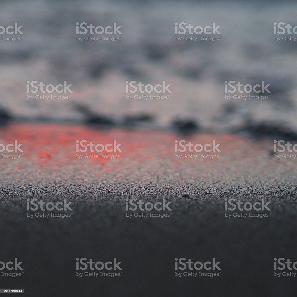 Grains of sand on the lake shore closeup stock photo