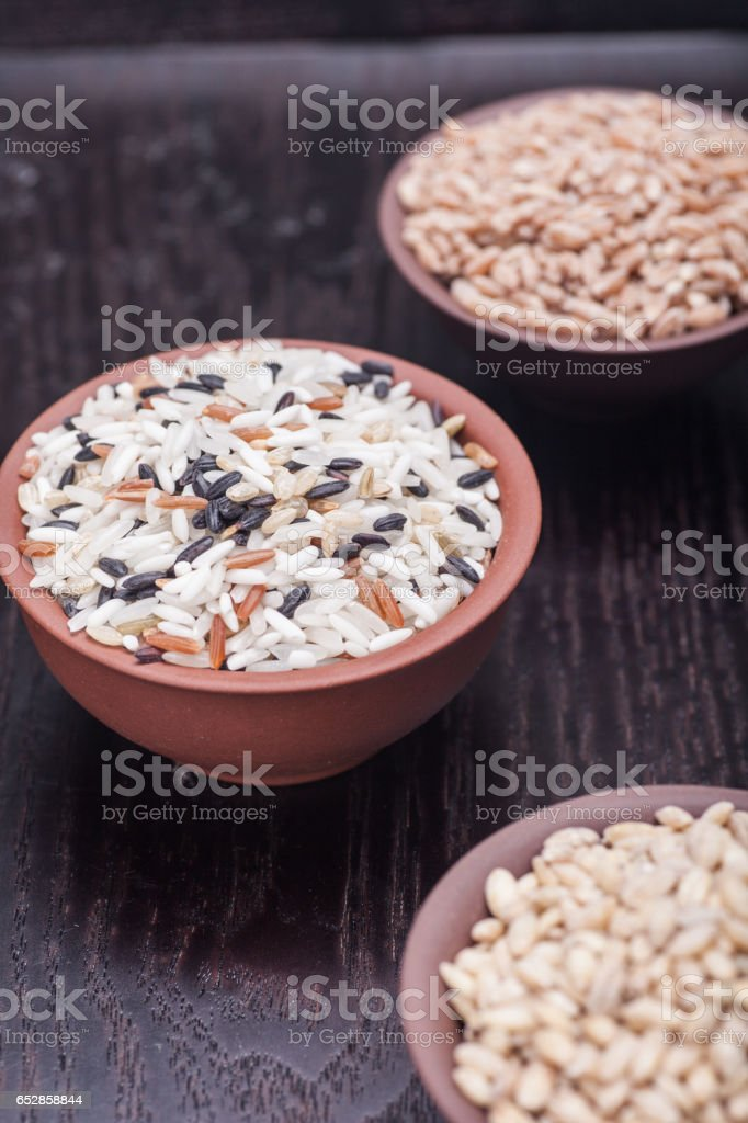 Grains, rice, black rice, brown rice in the Chinese bowl stock photo