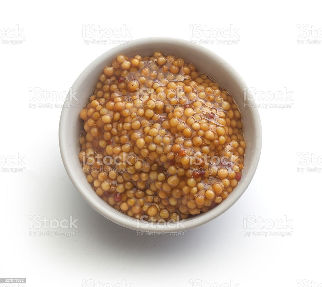 Grainy mustard in the white plate stock photo