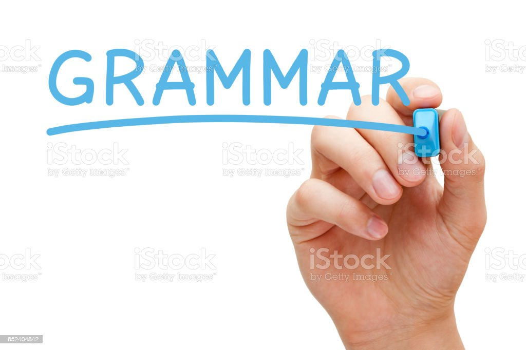 Grammar Handwriting With Blue Marker stock photo