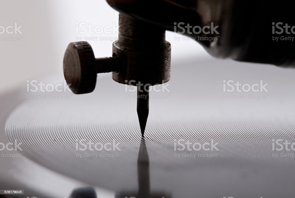 gramophone needle playing record stock photo