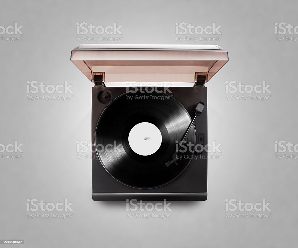 Gramophone vinyl player playing record, top view, isolated, clipping path. stock photo
