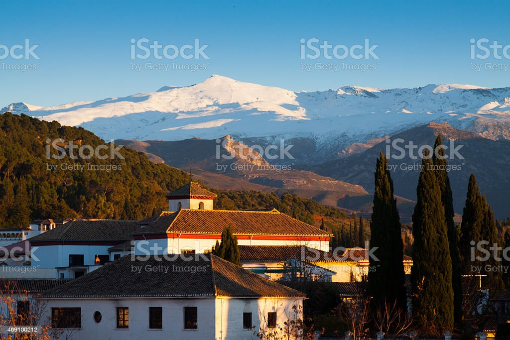 Granada in evening with Sierra Nevada in  background stock photo