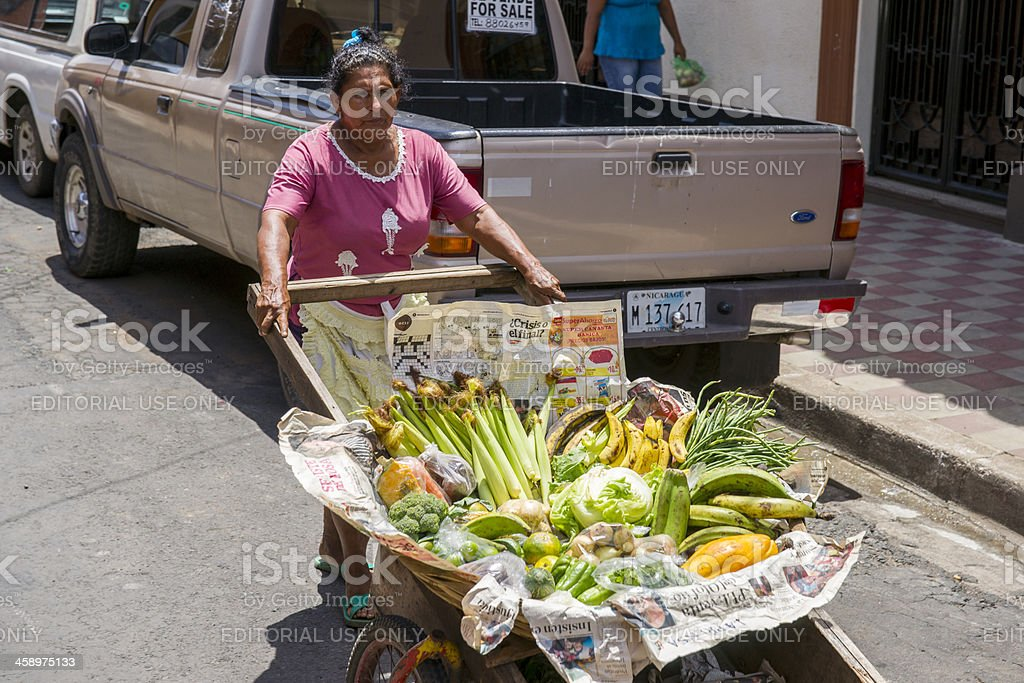 Granada, Nicaragua, street vendor selling produce from her barrow stock photo