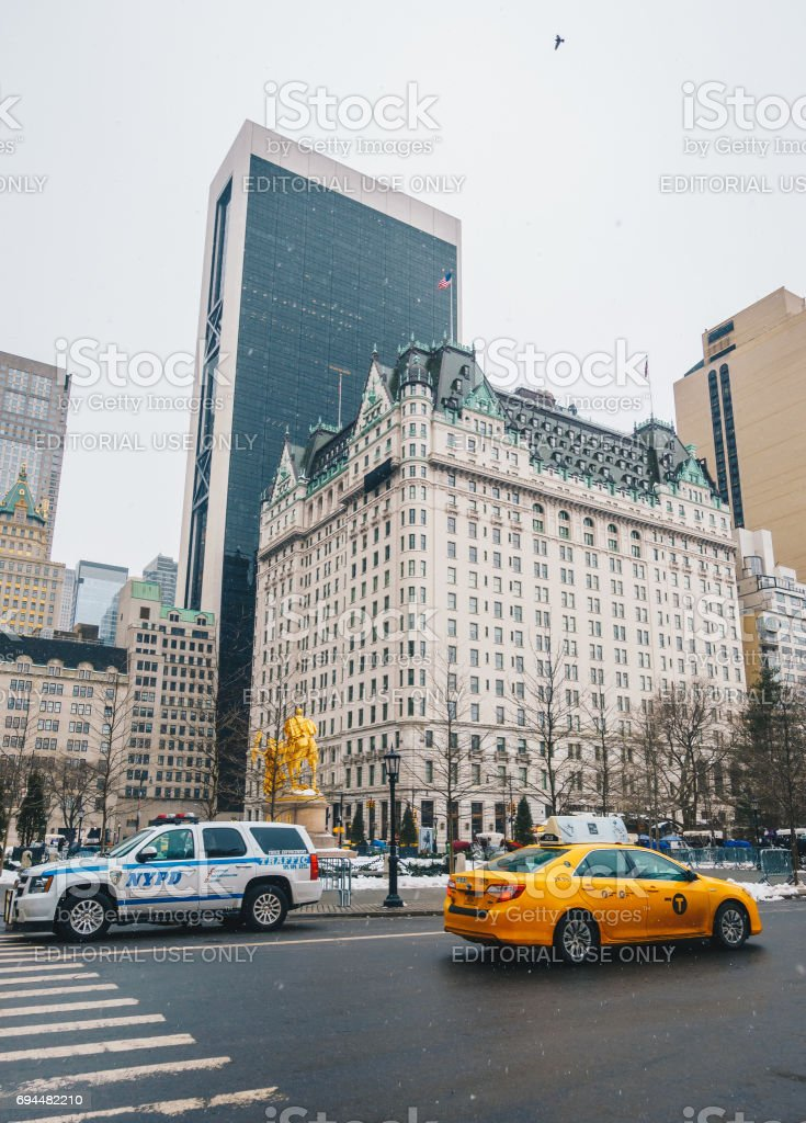 Grand Army Plaza lies at the intersection of Central Park South and Fifth Avenue in front of the Plaza Hotel in Manhattan. stock photo