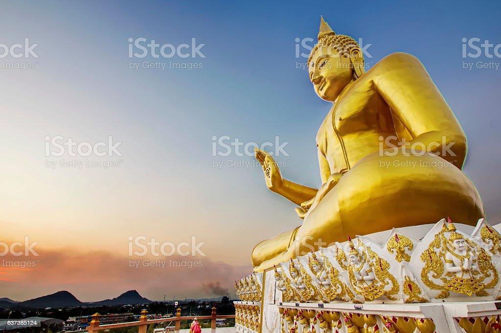 Grand big Buddha sculpture landmark with evening twilight sky background stock photo