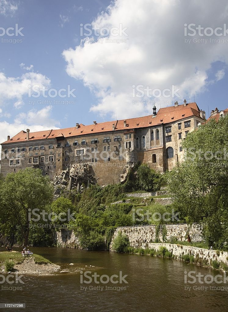 Grand building above curving river stock photo