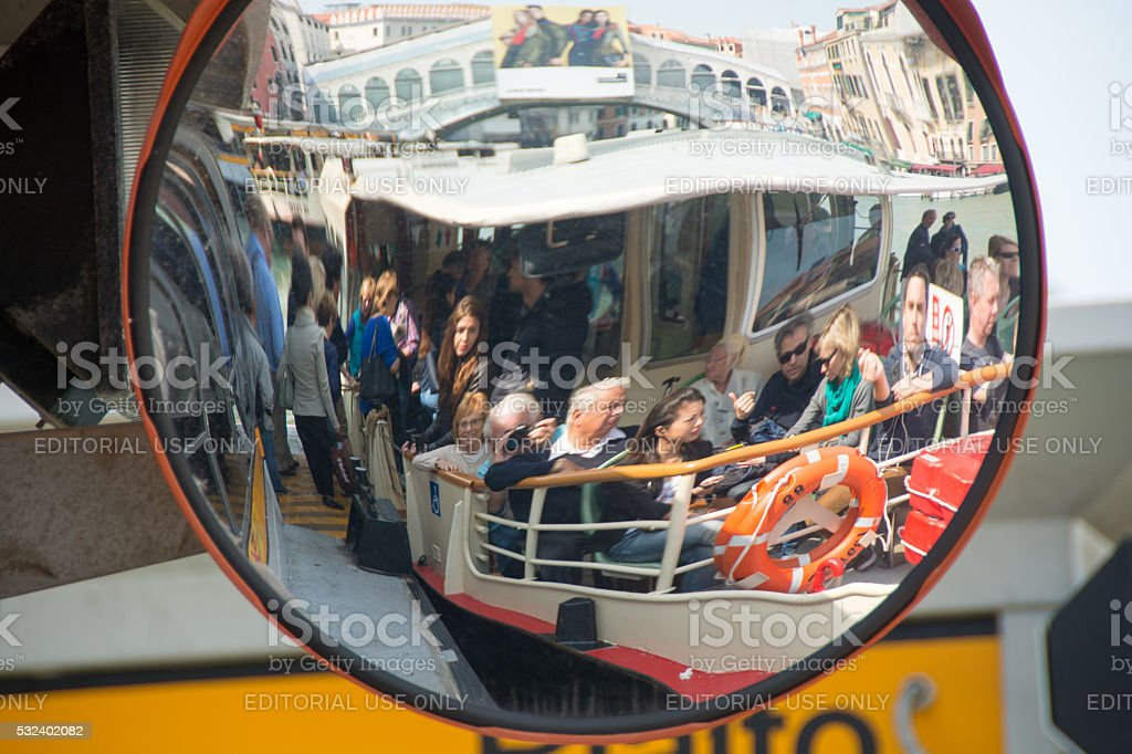 Grand Canal- A vapoetto with passengers shown in dock mirror stock photo
