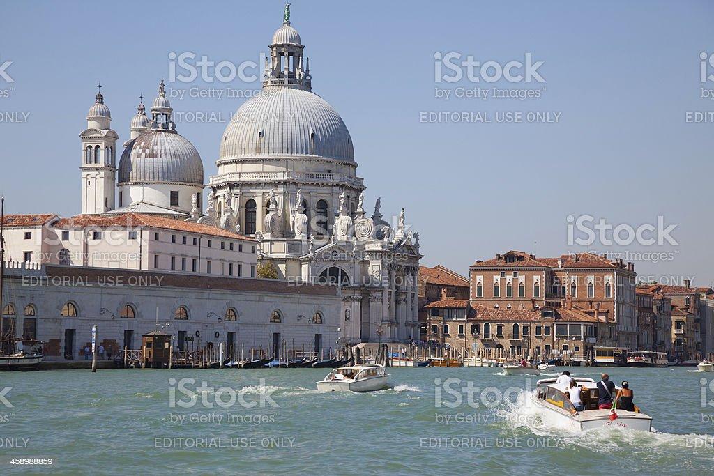 Grand Canal Gondolas and Taxi Boat, Venice, Italy royalty-free stock photo