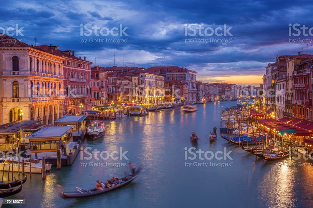 Grand Canal of Venice after sunset with gondola stock photo