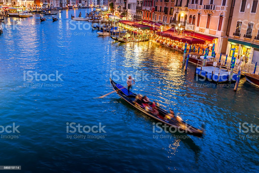 Grand Canal with blurred boat at dusk - Venice, Italy stock photo