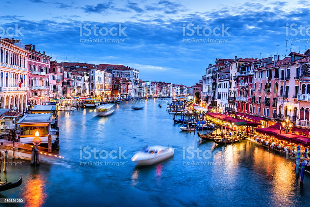 Grand Canal with boat at dusk - Venice, Italy stock photo