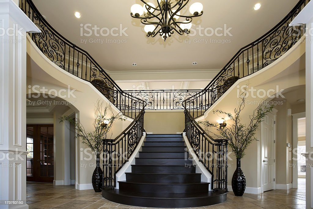 Grand entryway with dual iron staircase interior - Images escaliers interieur maison ...