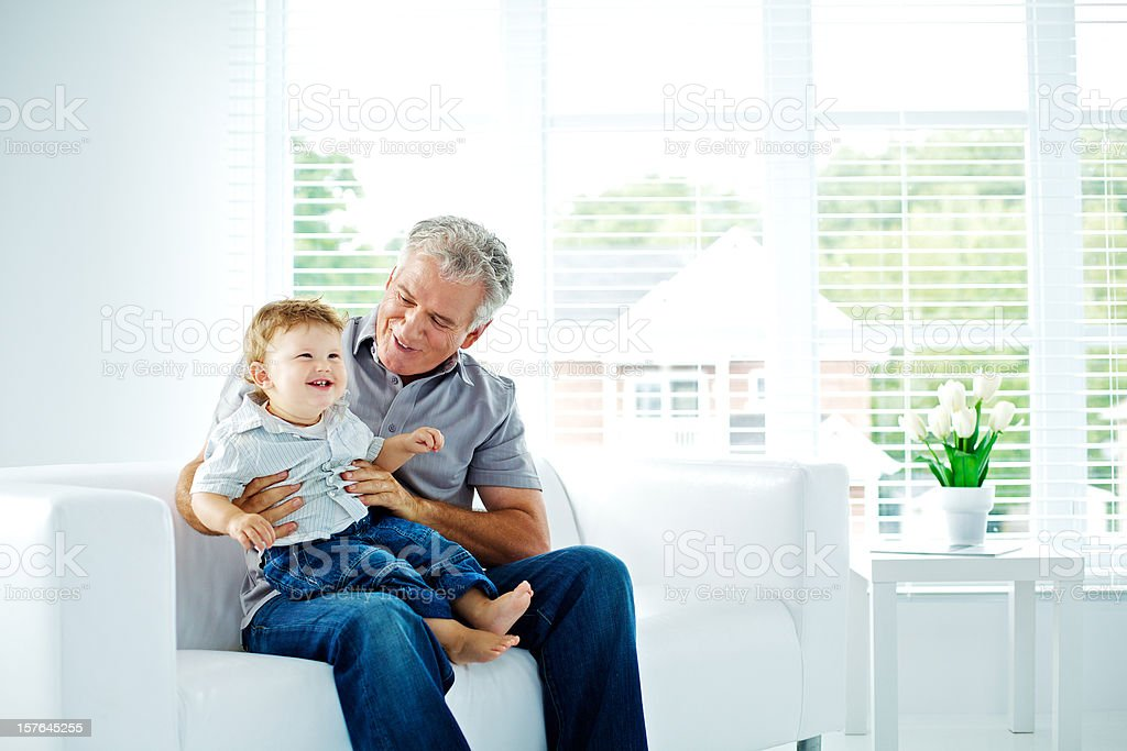 Grand father and little son having fun royalty-free stock photo