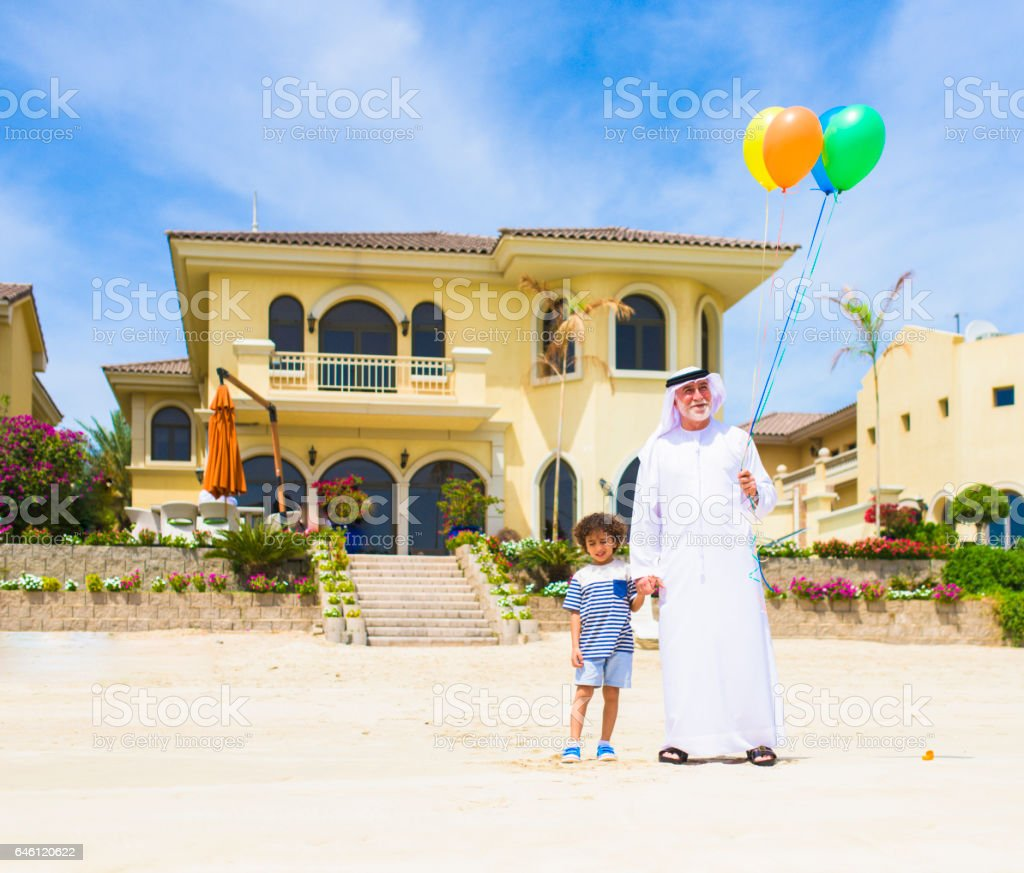 Grand Father and son with balloons on the beach stock photo