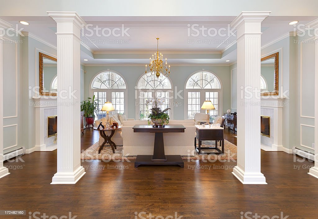 Grand Foyer and Living Room With White Pillars, Half-Round Windows stock photo
