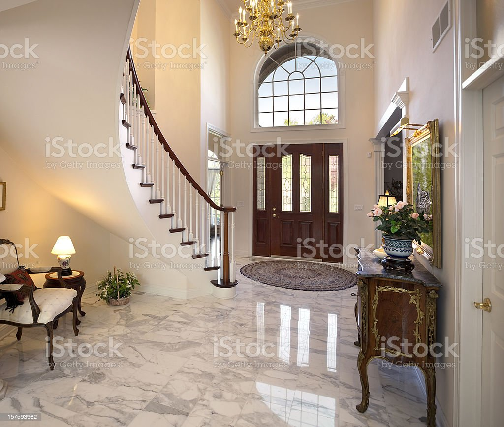 Grand Foyer; Staircase, Chandelier, Marble Floor Showcase Home Interior Design stock photo