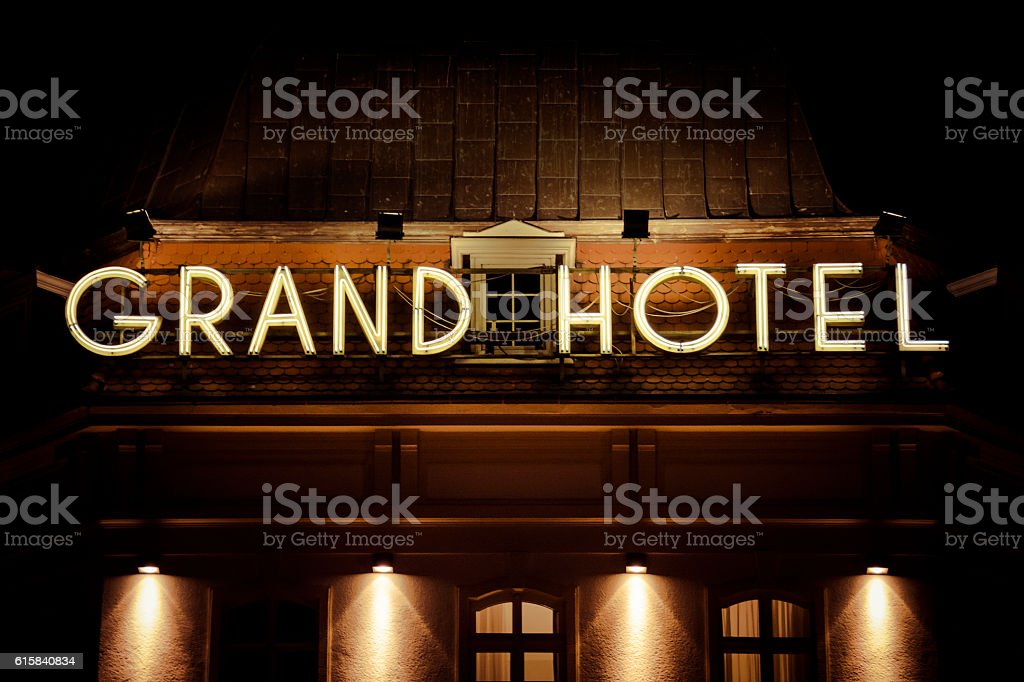 Grand hotel neon sign photographed after dark stock photo