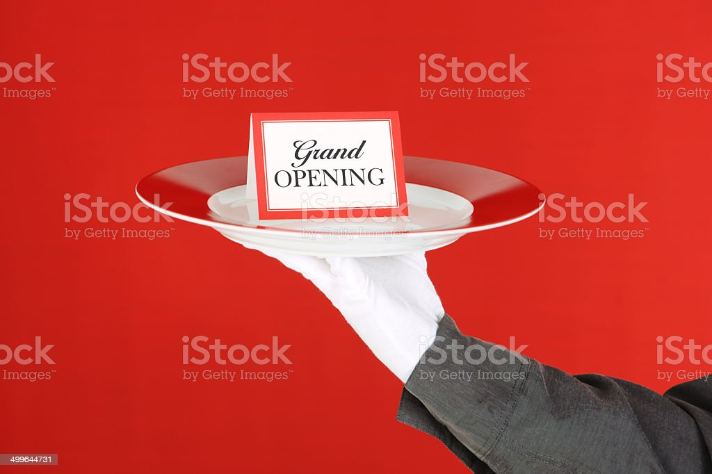 Grand Opening Card On Platter Held By Waiter royalty-free stock photo