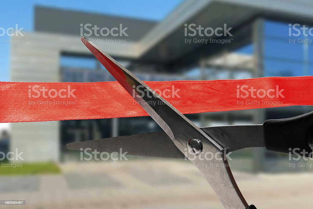 grand opening ceremony - cutting red ribbon stock photo