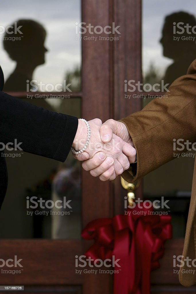 Grand Opening - Handshake royalty-free stock photo