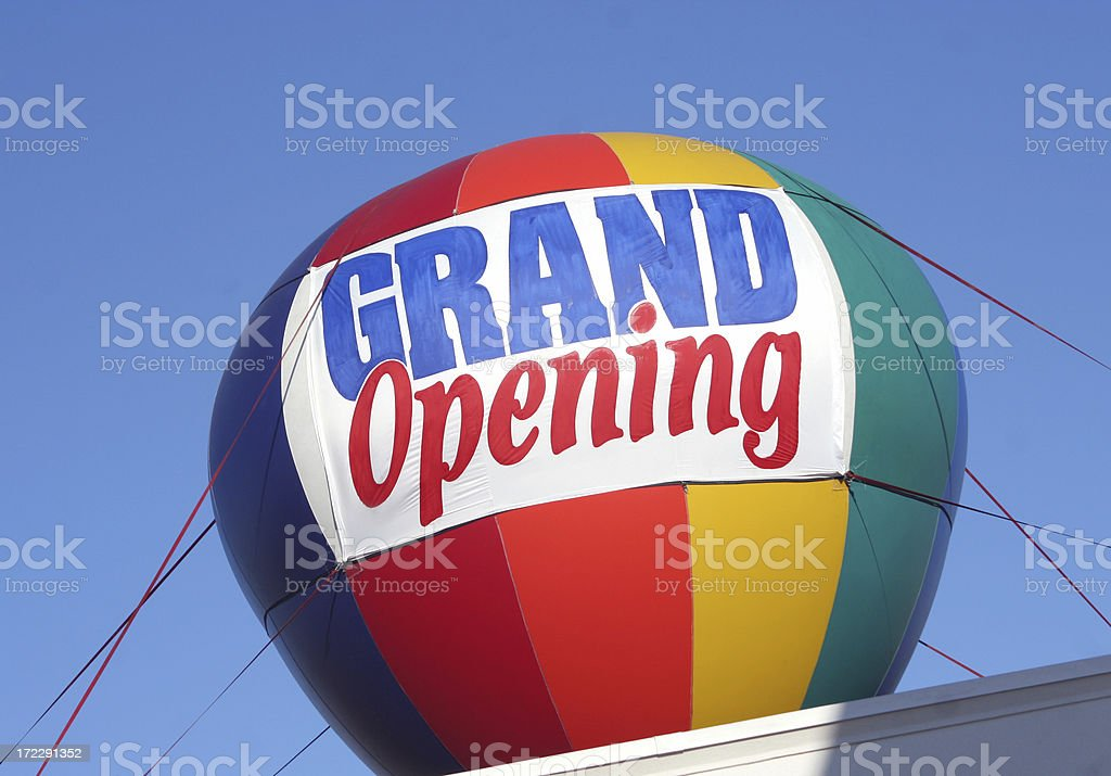 Grand Opening Sign - colorful hot air balloon stock photo