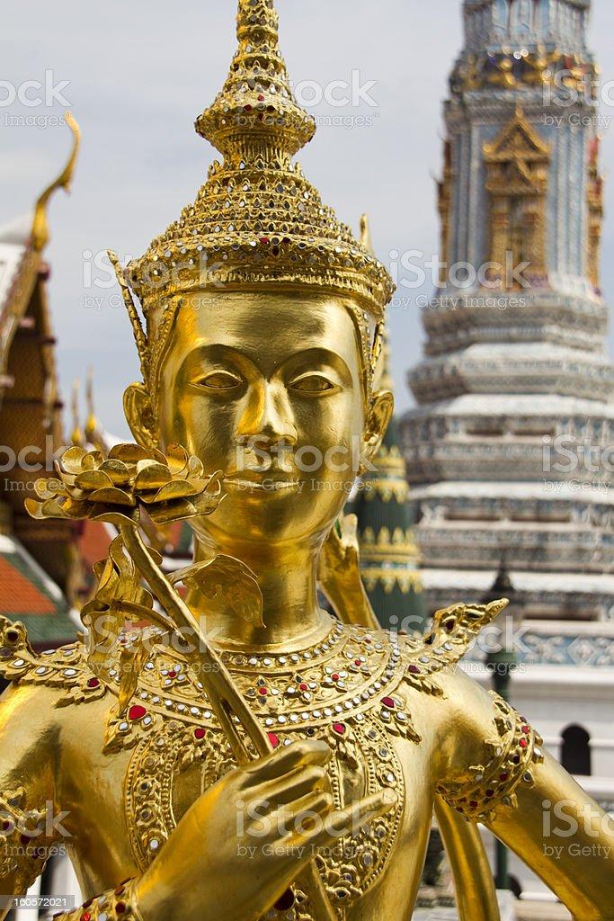Grand Palace in Bangkok, Thailand - Kinnari statue royalty-free stock photo