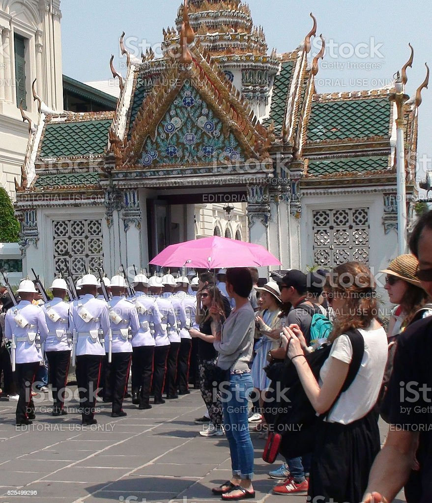 Grand Palace Visitors Watching Ceremonial Soldiers Parading In Bangkok.Thailand.Asia stock photo