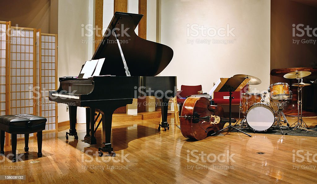 Grand piano, bass and drams on stage stock photo