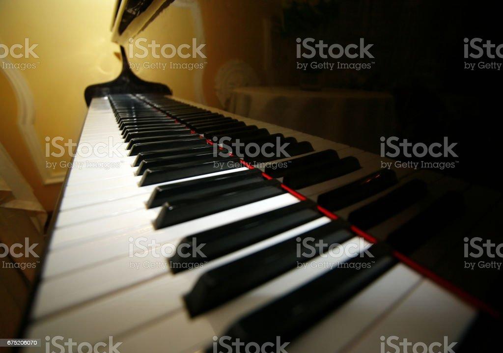 Grand piano ebony and ivory keys stock photo