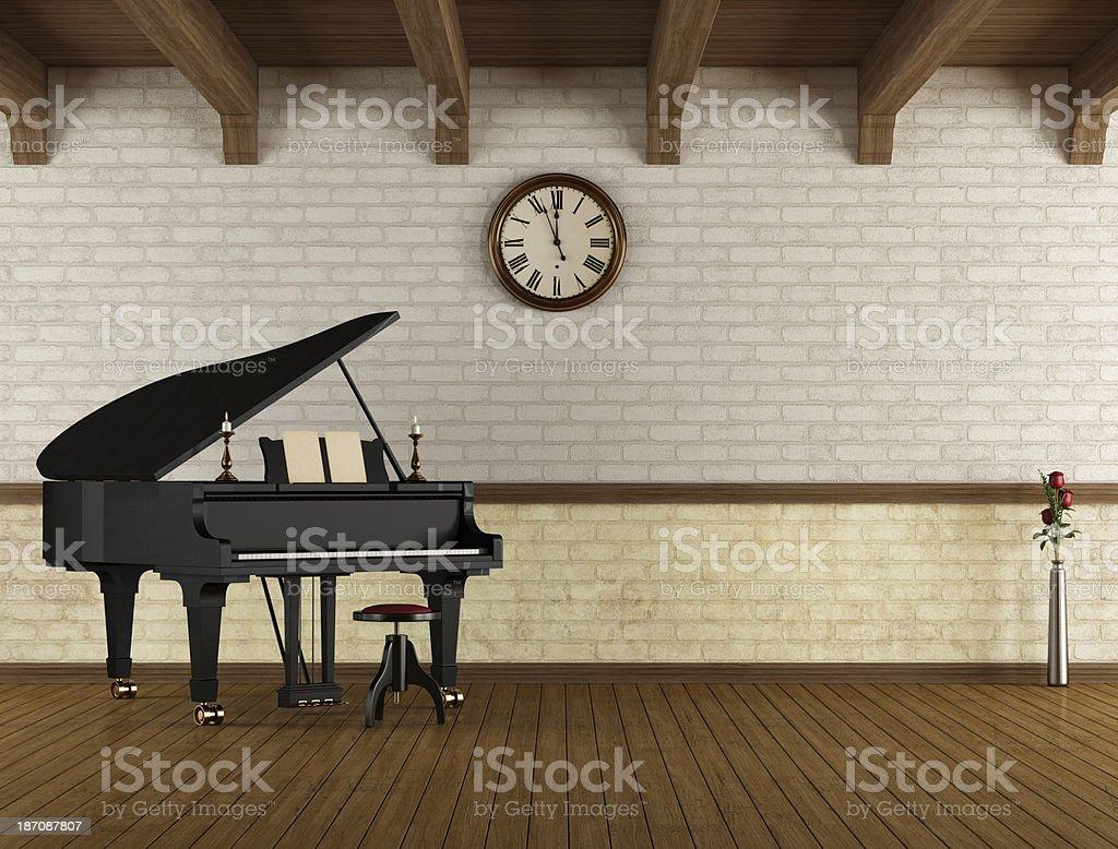 Grand piano in a empty room stock photo
