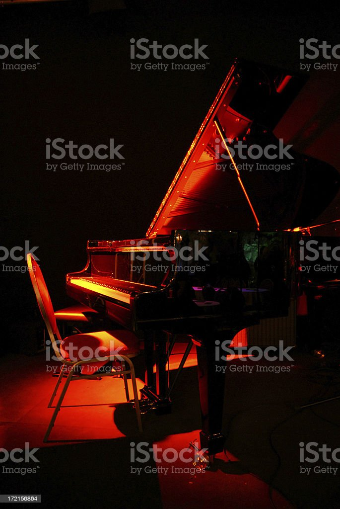 Grand piano in red concert light royalty-free stock photo