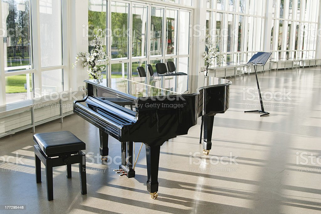 Grand piano in the hall stock photo