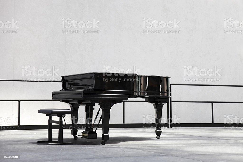 grand piano on stage stock photo