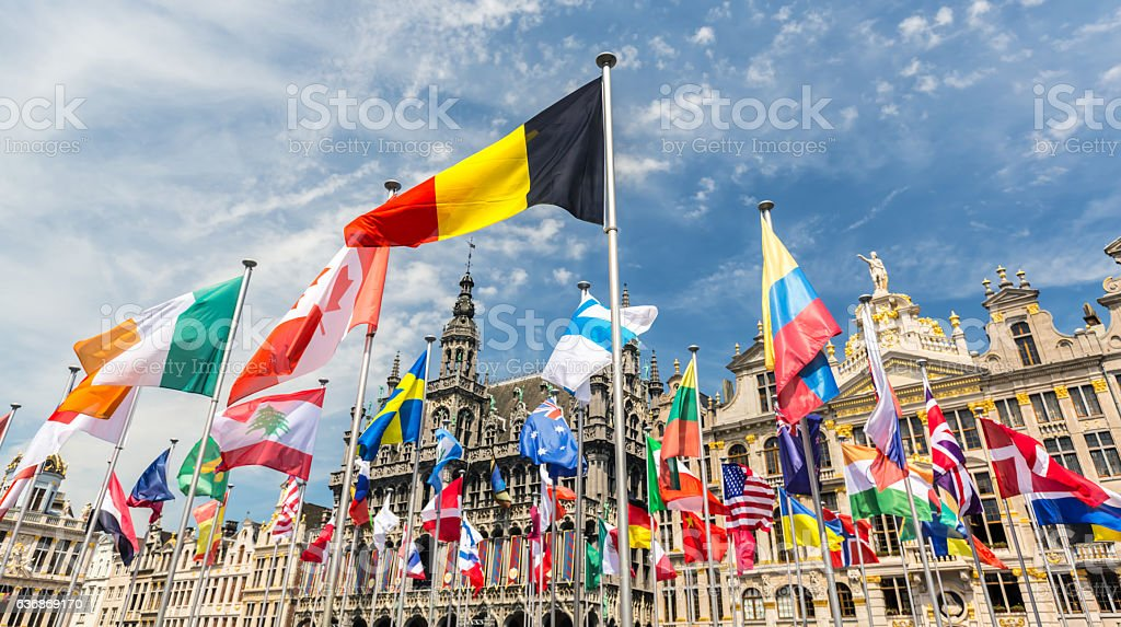 Grand Place in Brussels with many international flags stock photo
