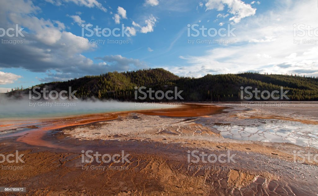 Grand Prismatic Hot Spring under sunset clouds in the Midway Geyser Basin in Yellowstone National Park in Wyoming USA stock photo