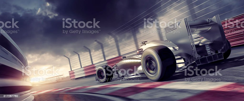Grand Prix High Speed Racing Car On Racetrack At Sunset stock photo