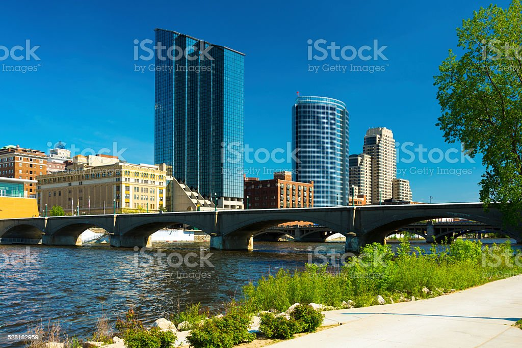 Grand Rapids skyline, bridge, river, and walkway stock photo