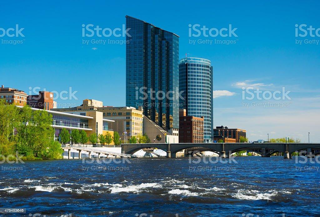 Grand Rapids skyline with rapids of Grand River, and bridge stock photo