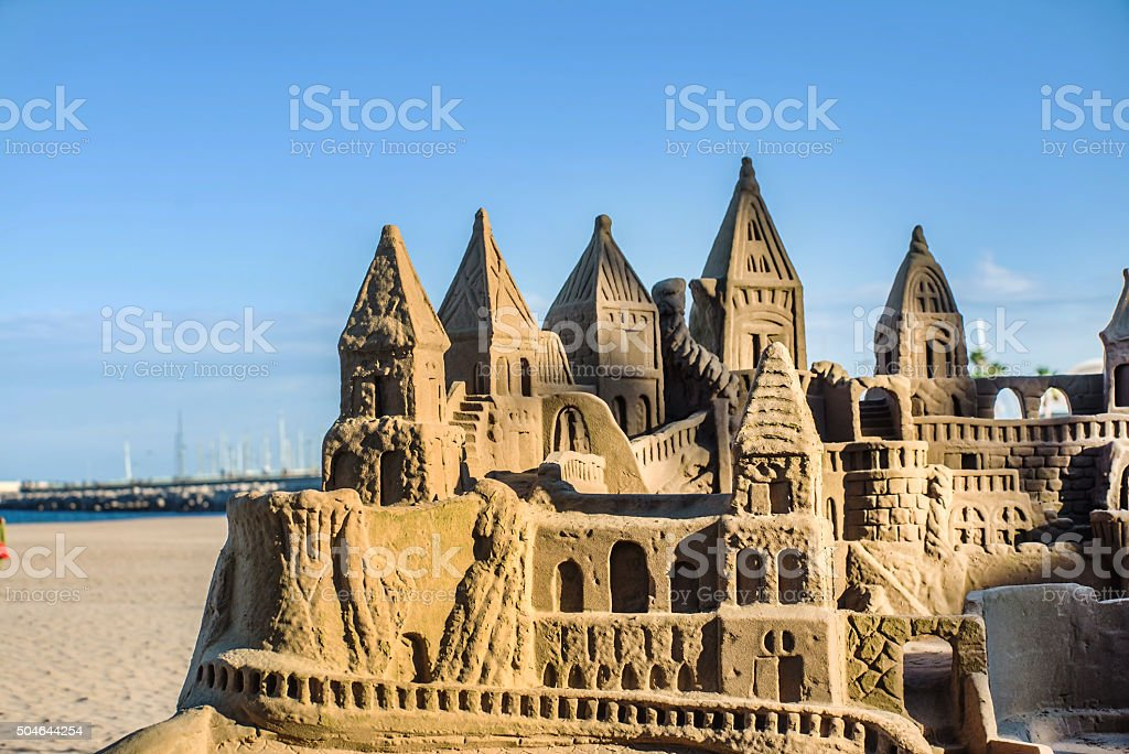 Grand sandcastle on the beach stock photo