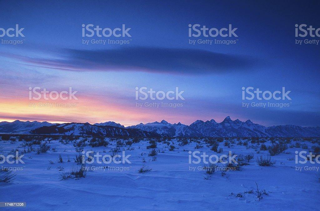 Grand Teton Mountain Range at Dusk in WInter royalty-free stock photo