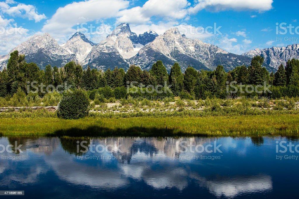 Grand Teton Mountain Range Reflected in Snake River stock photo